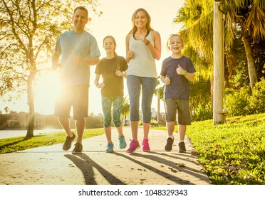 Family exercising and jogging together at an outdoor park