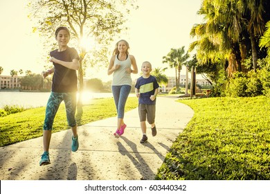 Family exercising and jogging together at the park
