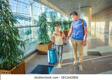 Family in face mask in airport. Father and child wear facemask during coronavirus and gripp