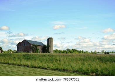 Family farm with surrounding farmland and country landscape