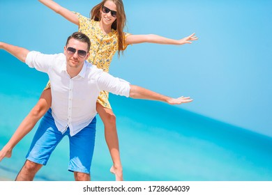 Family of father and his daughter on the beach vacation