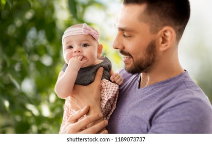 family, fatherhood and people concept - close up of father with little baby daughter