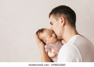family, fatherhood and people concept - happy father holding little baby daughter at home