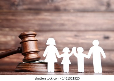 Family figures with gavel on brown wooden table