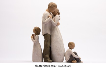 family of figurines 4 figures