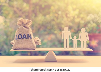 Family finance / financial loan and risk management concept : Loan bags, white acrylic cut (dad, mom, son) on basic balance scale, depicts loan between family members, not use a bank or credit union.
