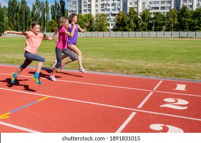 Family fitness, mother and kids running on stadium track, exercise with children  and sport healthy lifestyle concept