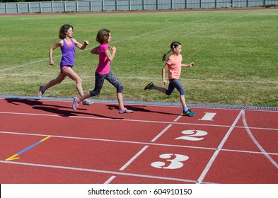 Family fitness, mother and kids running on stadium track, training and children sport healthy lifestyle concept