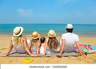 Family of five on the beach. Travel and family vacation concept