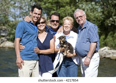 family of five with three generations in the summer