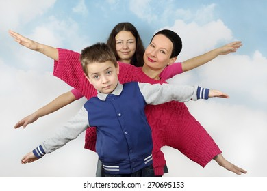 Family flying in cloudy blue sky - love of travel and wanderings concept - mother, daughter and son