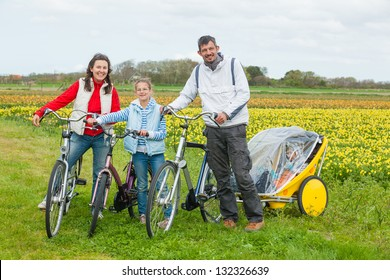Family of four with bicycle on a spring day in Holland