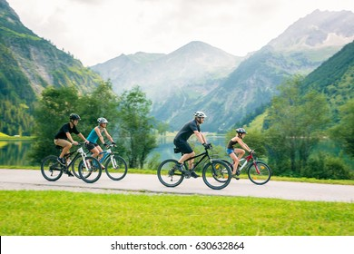 Family Of Four Cycling