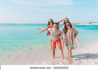 Family of four on the beach vacation