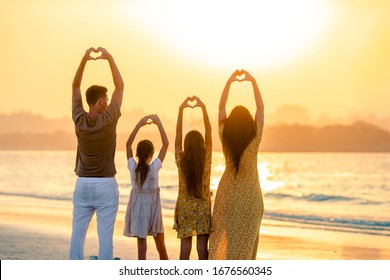 Family of four on the beach vacation in Dubai. United Arab Emirates famous tourist destination.