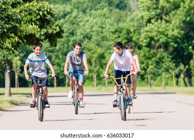 Family of four on bike tour in summer