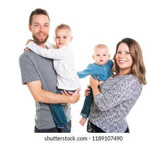 Family of four on studio white background