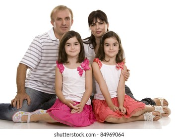 family of four on white isolated background