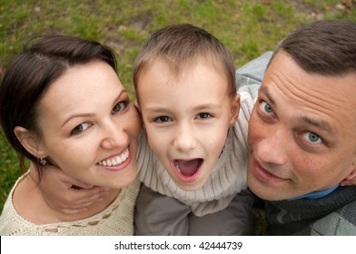 family of four people in the park