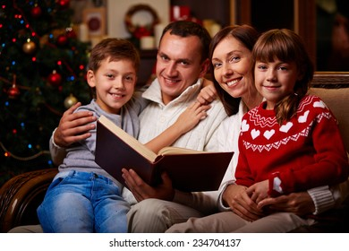 Family of four reading tales on Christmas evening