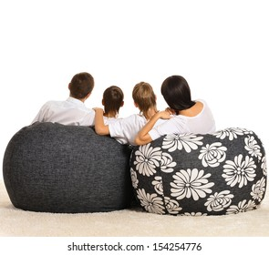 Family of four watching tv on white background