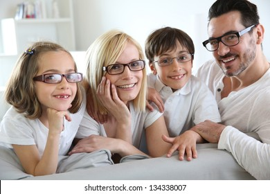 Family of four wearing eyeglasses