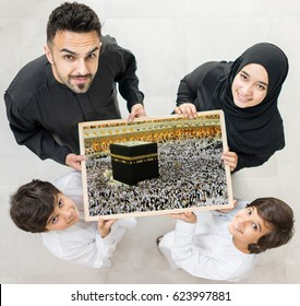 Family with a frame of Kaaba in Mecca