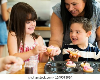 Family with fresh homemade cucakes