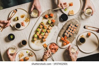 Family or friends having Japanese traditional sushi dinner at quarantine