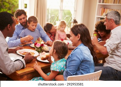 Family and friends sitting at a dining table
