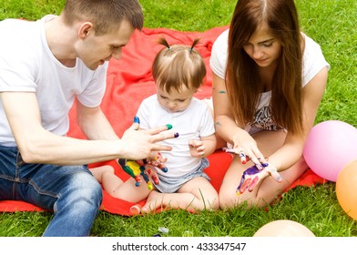 Family fun is resting in nature. Paint colors each other