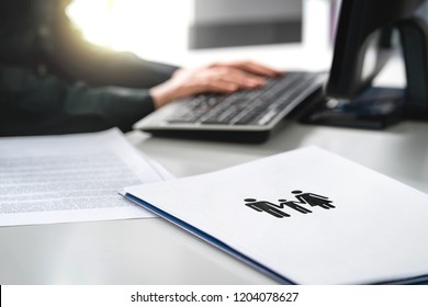 Family future, health care or finance planning concept. Woman writing insurance or mortgage application with computer. Lawyer working on legal case about custody battle, adoption or abortion law.