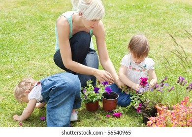 Family in the garden with flowers in the sunshine