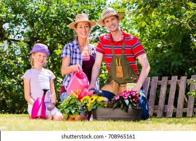 Family gardening in garden working