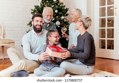 Family gathered around a Christmas tree