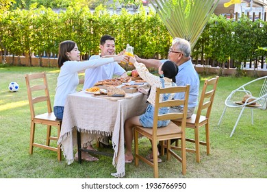 The family gathered for a meal on the holiday, Family garden party celebration on the weekend.