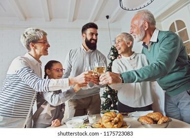 Family gathered over Christmas holidays, celebrating, having lunch