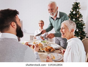 Family gathered over for Christmas holidays, celebrating, having lunch