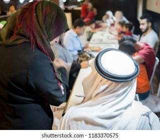 Family gathering for food in restaurant