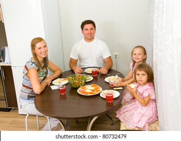 Family gathers for dinner at the table