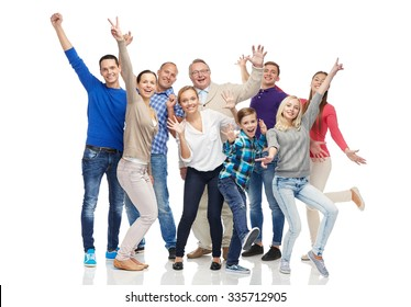 family, gender, generation and people concept - group of smiling men, women and boy having fun and waving hands