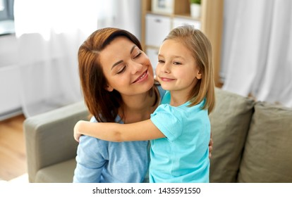 family, generation and people concept - little daughter hugging her happy mother at home