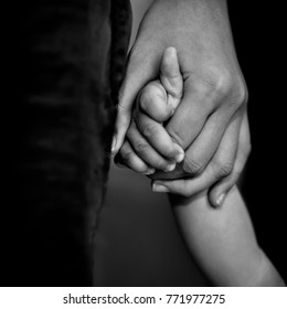family, generation, support and people concept - senior man and child holding hands