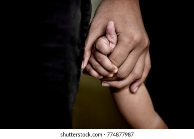 family, generation, support and people concept -senior man and child holding hands