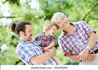 Family Generations: Father, son and Granddad, outdoors, in Nature, enjoying their Quality Time together, All in Checkered Shirts