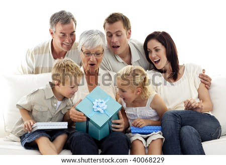Family Giving A Present To Grandmother For Her Birthday