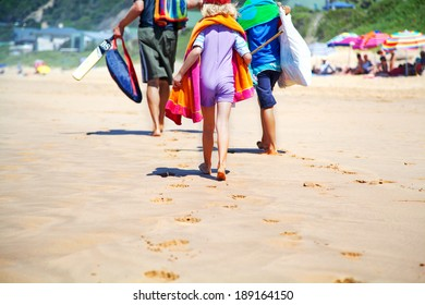 family going to the beach