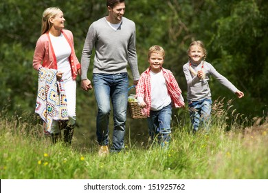 Family Going On Picnic In Countryside