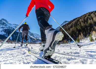 A family group of cross country skiers on a sunny winter morning in Italy Alps, South Tirol, Solda.