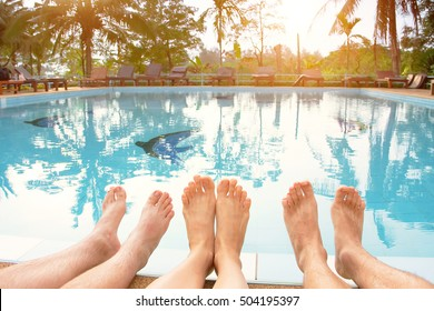 Family or group of friends relaxing near swimming pool